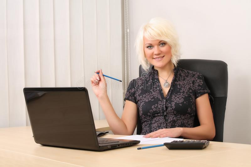 Pretty business woman with notebook in the office royalty free stock photo
