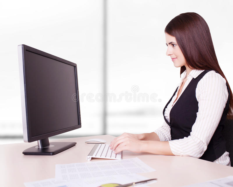 Pretty business woman at office desk royalty free stock images