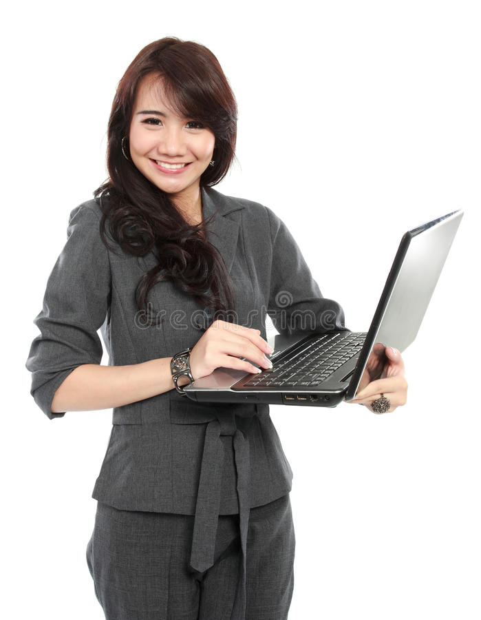 Pretty business woman. Portrait of pretty business woman typing on laptop royalty free stock photo