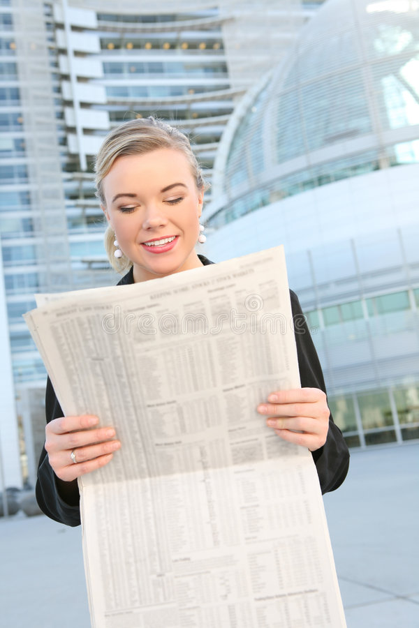 Pretty Business Woman Reading Newspaper stock images
