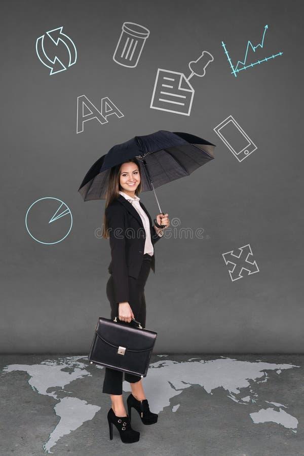 Pretty businesswoman holding umbrella. On grey background. Map from NASA stock illustration