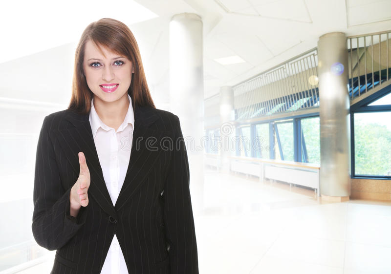 Pretty businesswoman. In office building stock photography