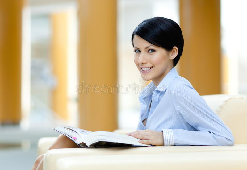Download Pretty Businesswoman Rests At The Sofa With Book Stock Image - Image: 26631053