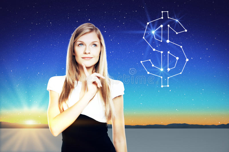 Pretty businesswoman thinking about money. On beautiful background with stars in the sky, landscape and sunset royalty free stock photo