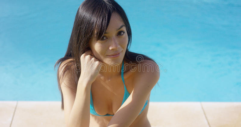 Pretty busty young woman in a bikini royalty free stock images