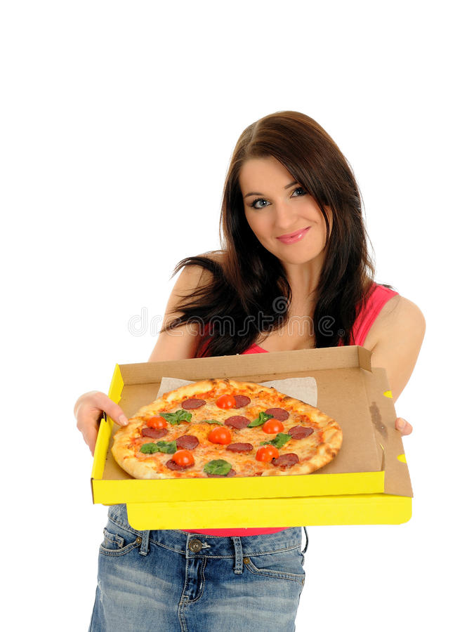 Pretty casual girl with pizza in delivery box royalty free stock photos