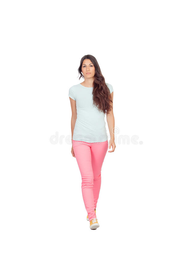 Pretty casual girl walking royalty free stock images