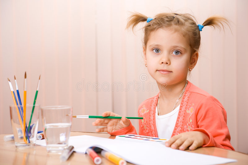 Pretty caucasian child paint stock images