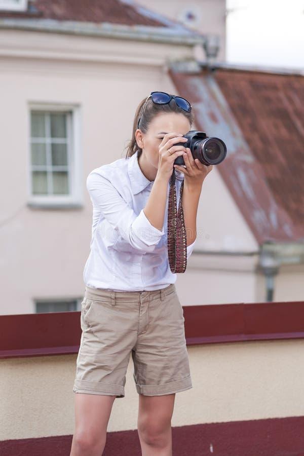 Pretty caucasian Female Photographer Taking Pictures stock photos