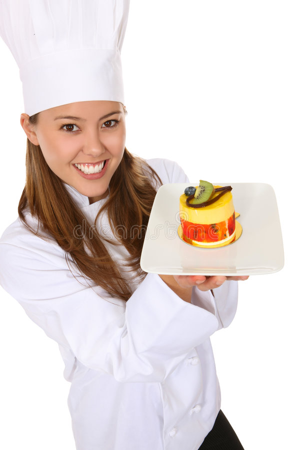 Pretty Chef Cooking Dessert. A pretty woman chef holding a dessert isolated over white royalty free stock photos