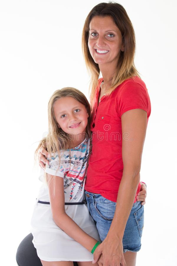 Child girl posing with love mother fit and pretty slim family royalty free stock photo