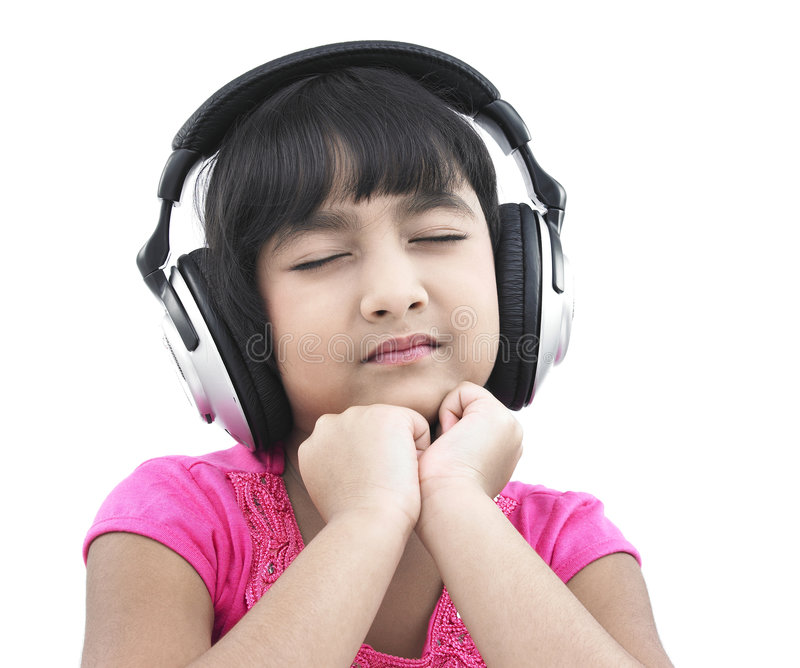 Pretty Child Listening To Music Royalty Free Stock Photography