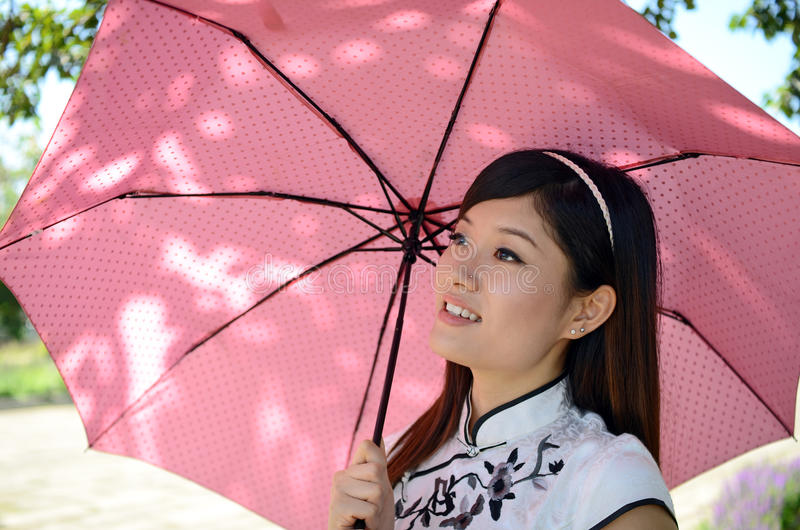Pretty chinese woman holding umbrella royalty free stock image
