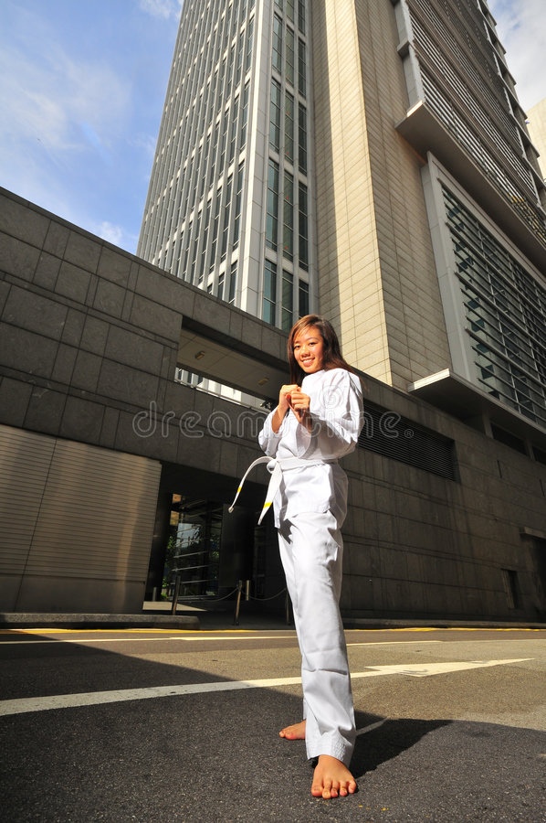 Pretty Chinese Woman in Karate stance on street royalty free stock image