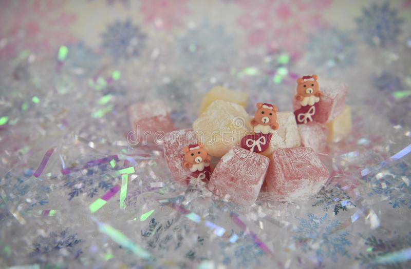 Pretty Christmas food photography picture of turkish delight jelly treats and cute teddy bear stocking iced decorations royalty free stock images