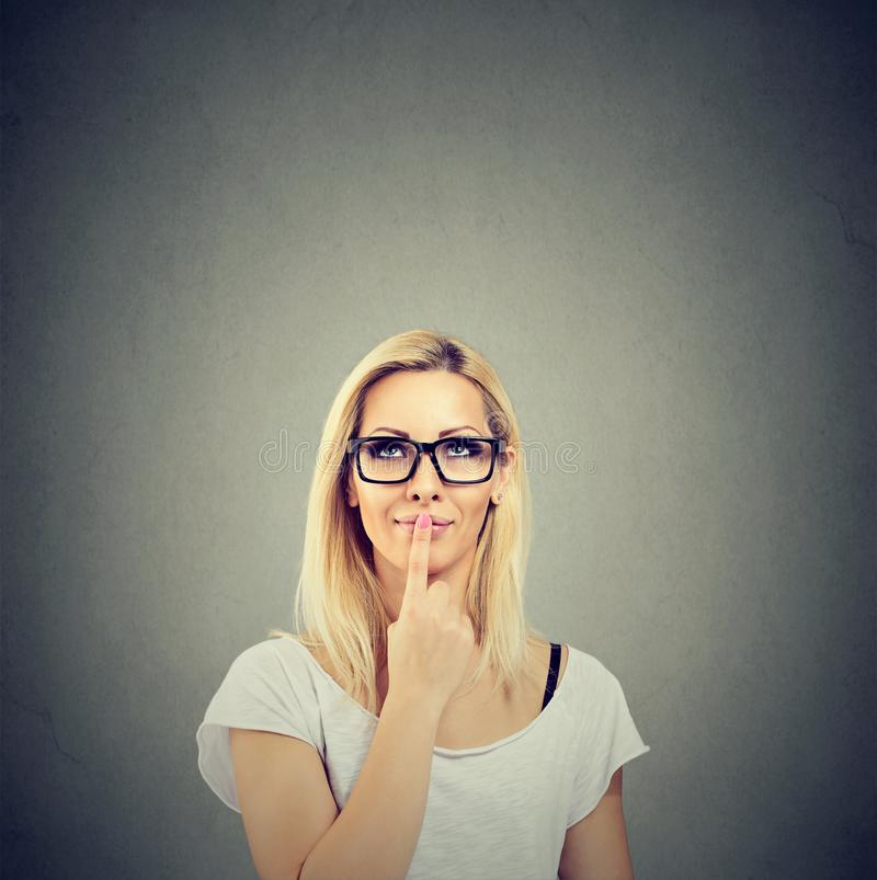 Daydreaming pretty blonde woman thinking stock photo