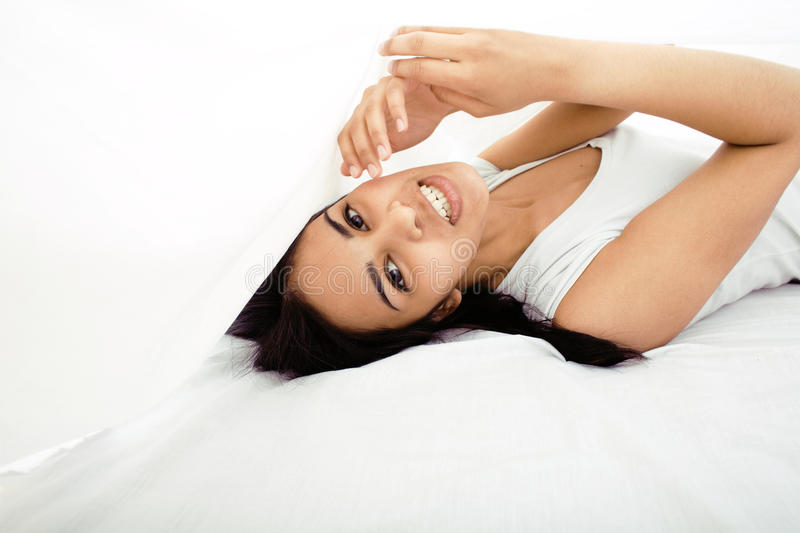 Download Pretty Cute Brunette Woman In Bed Under Sheets Stock Photo - Image: 31986484