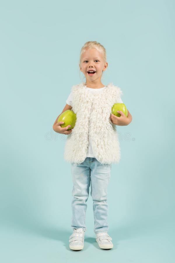 Pretty, cute girl in light clothes hold apples royalty free stock photo