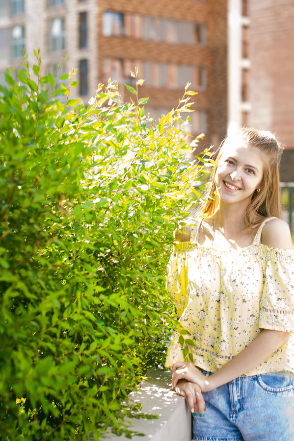Young beautiful woman, warm summer sunny day royalty free stock photo