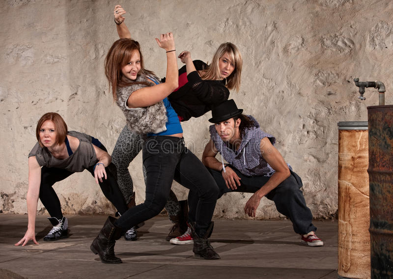 Pretty Dancer with Hip Hop Group stock photo