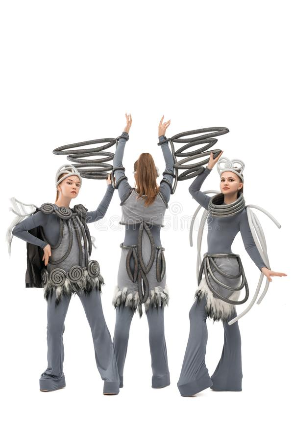 Pretty dancers in fantastic costumes isolated shot royalty free stock photo