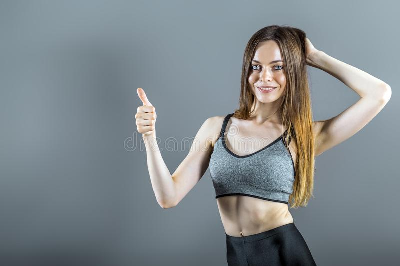 Portrait of Sportswoman with Thumb up Sign royalty free stock photo