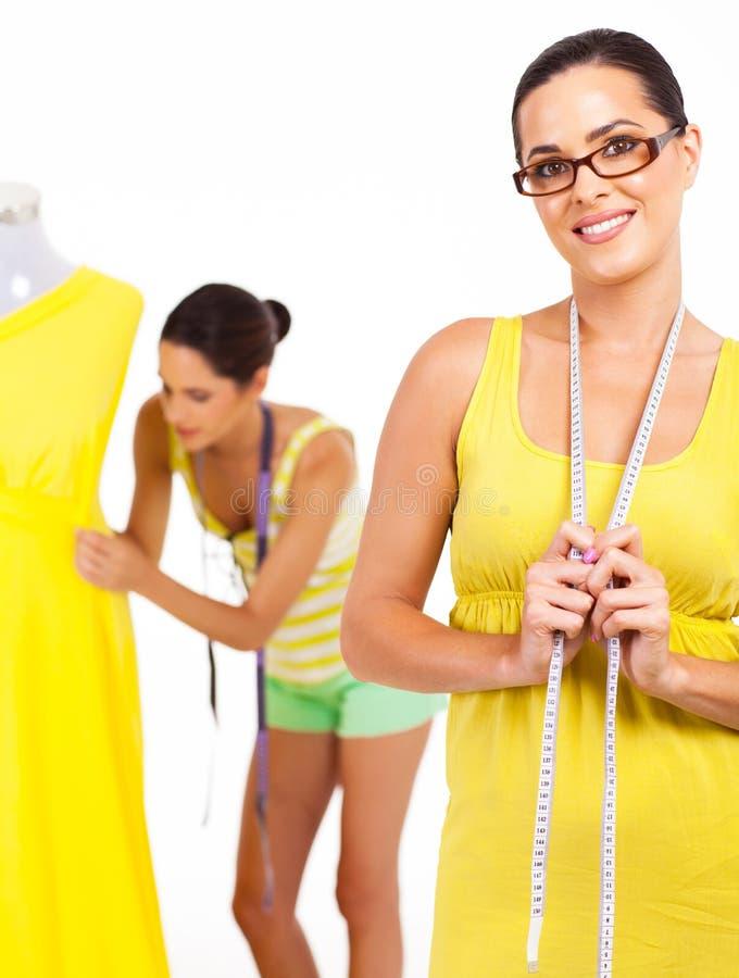 Pretty dressmaker royalty free stock photography