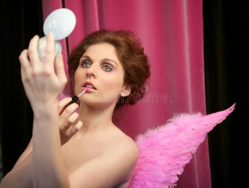Pretty elegant pinup girl, lipstick and wings royalty free stock photos