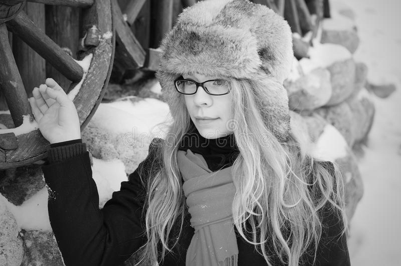 Pretty elegant woman in winter retro background