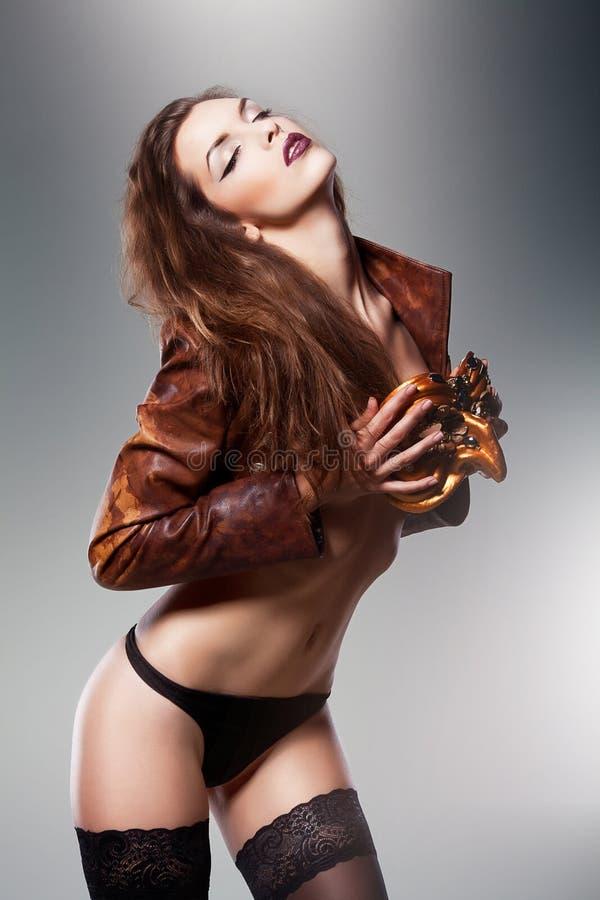 Pretty erotic woman in venetian mask stock photography