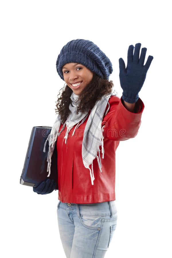 Pretty Ethnic Woman Waving At Wintertime Royalty Free Stock Image