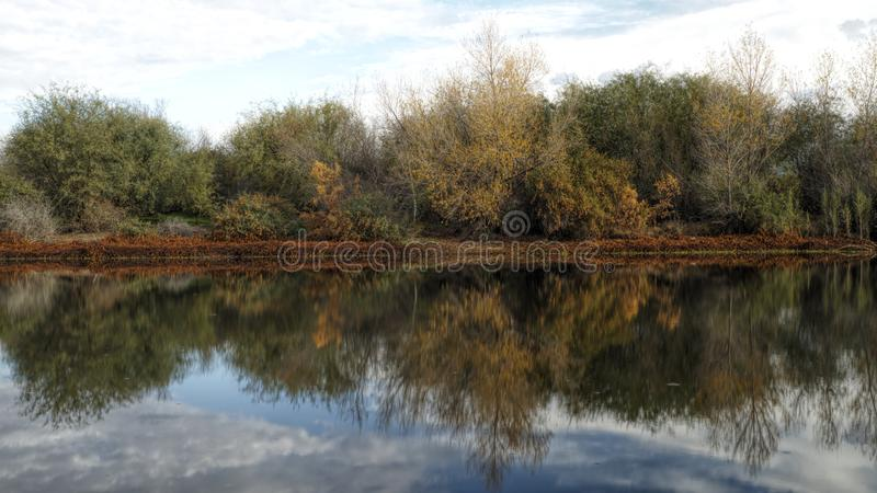 Pretty Even reflection on lake. Pretty Even, reflections, water, autumn, fall, image, vgphotoz, nature, oasis, colors, sky, unique, original, organic, beauty stock photos
