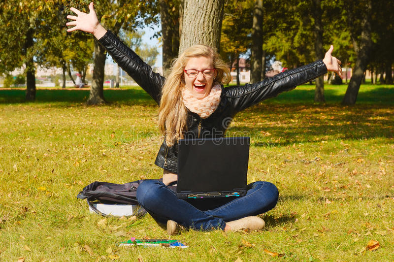 Download Pretty Excited Girl With A Laptop Stock Image - Image of happy, autumn: 22709621