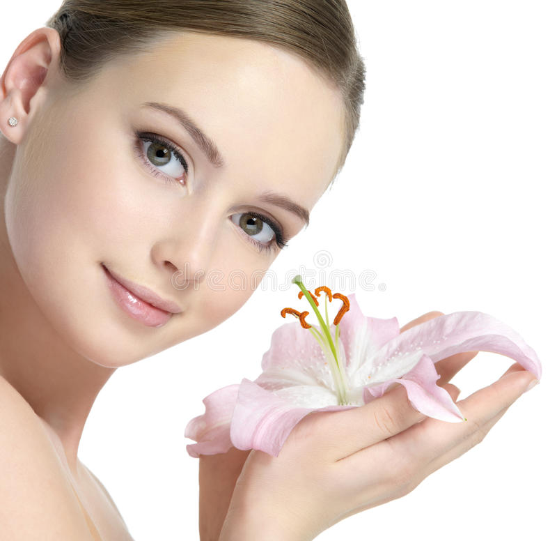 Pretty face of woman with lily stock photos