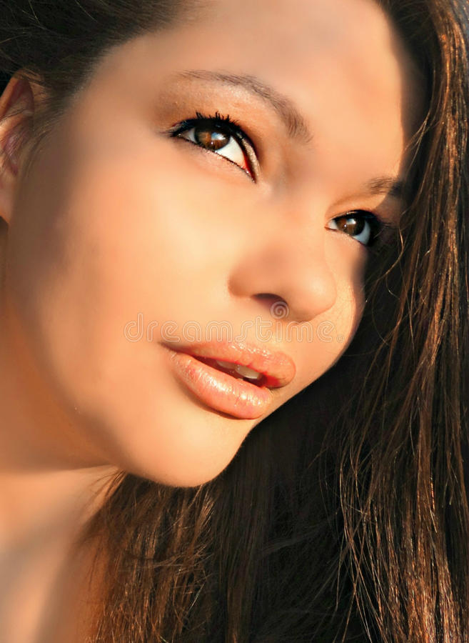 Young beautiful brunette woman with nude makeup smile and
