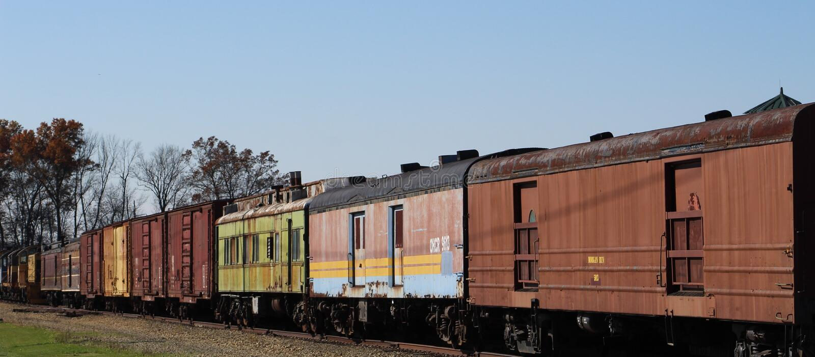 Colorful trains and bright fall days. A pretty fall day in Amish country and a colorful train royalty free stock image