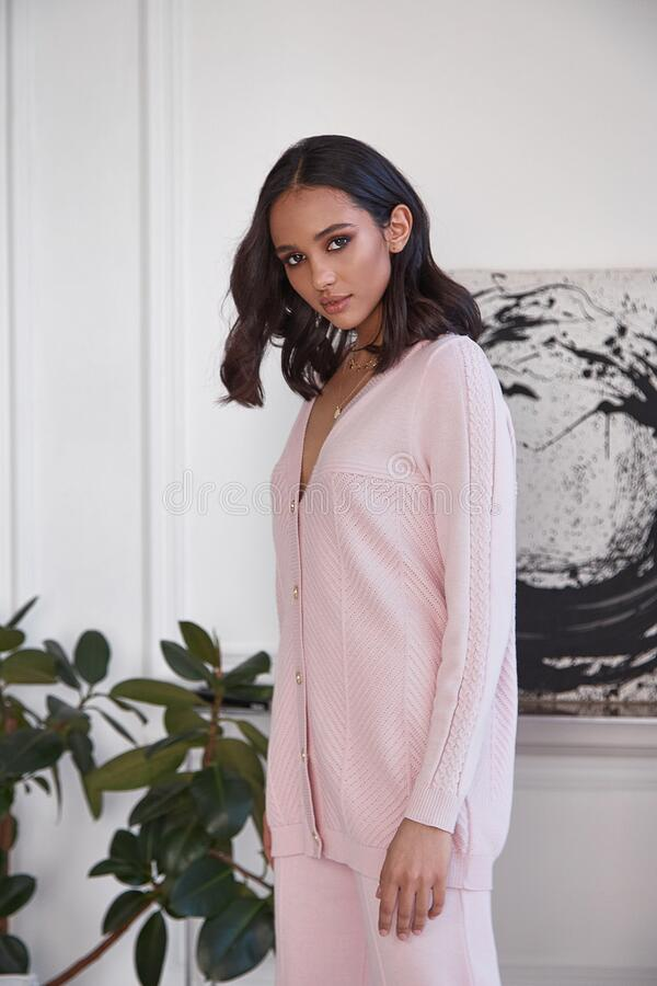 Free Pretty Fashion Beautiful Woman Sexy Lady Brunette Curly Hair Dark Tanned Skin Wear Trend Clothes Knitted Pink Pink Suit Jacket Top Royalty Free Stock Photography - 215877477
