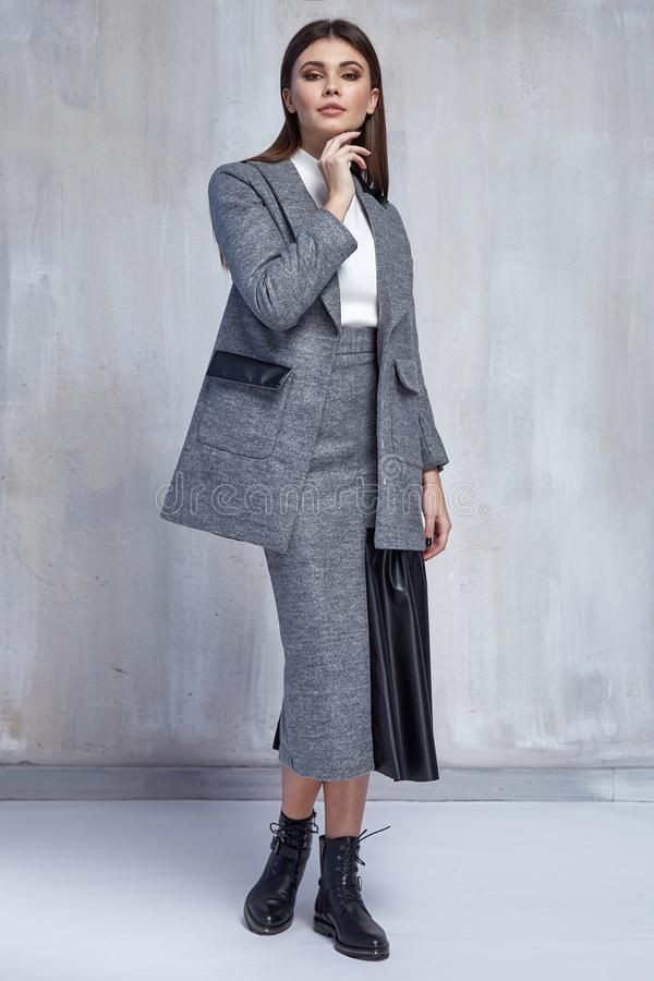 Pretty fashion woman wear wool skirt jacket casual trend clothes collection catalogue brunette hair party style model pose. Bright make-up beautiful face dress stock images