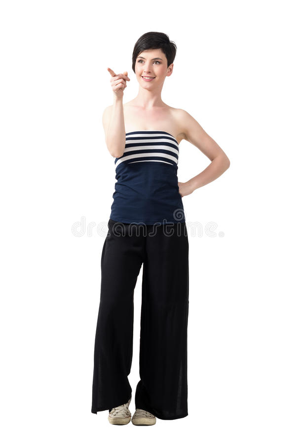 Pretty fashionable short hair woman pointing away and smiling royalty free stock image