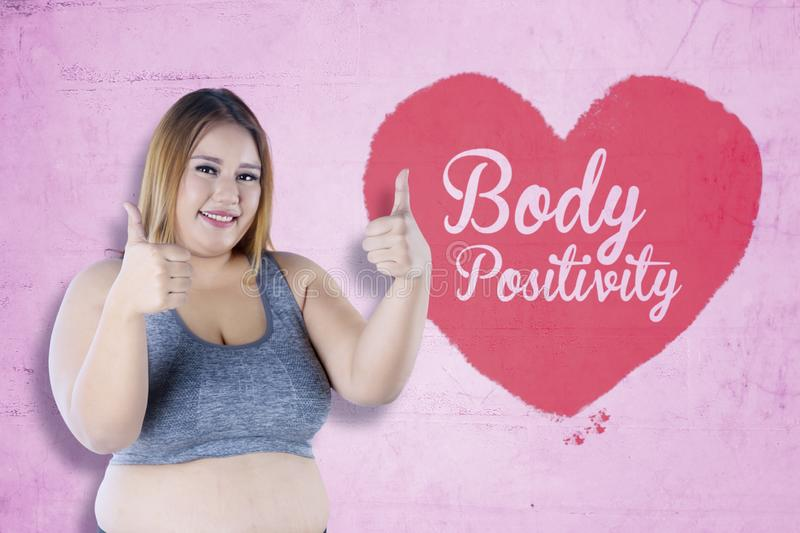 Pretty fat woman with text of body positivity royalty free stock photography
