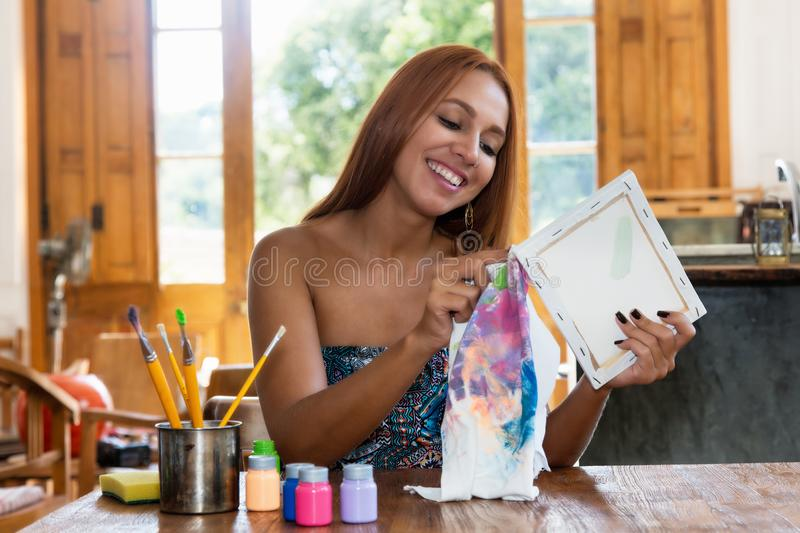 Pretty female artist painting at studio royalty free stock image
