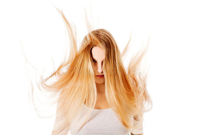 Pretty female with beautiful long blond hair stock photography