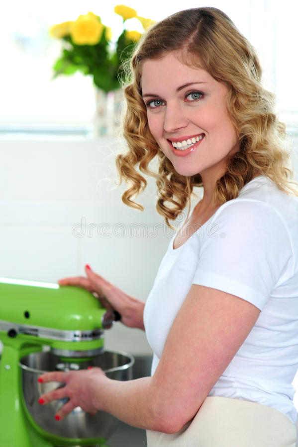 Download Pretty female chef at work stock photo. Image of bakery - 25621710