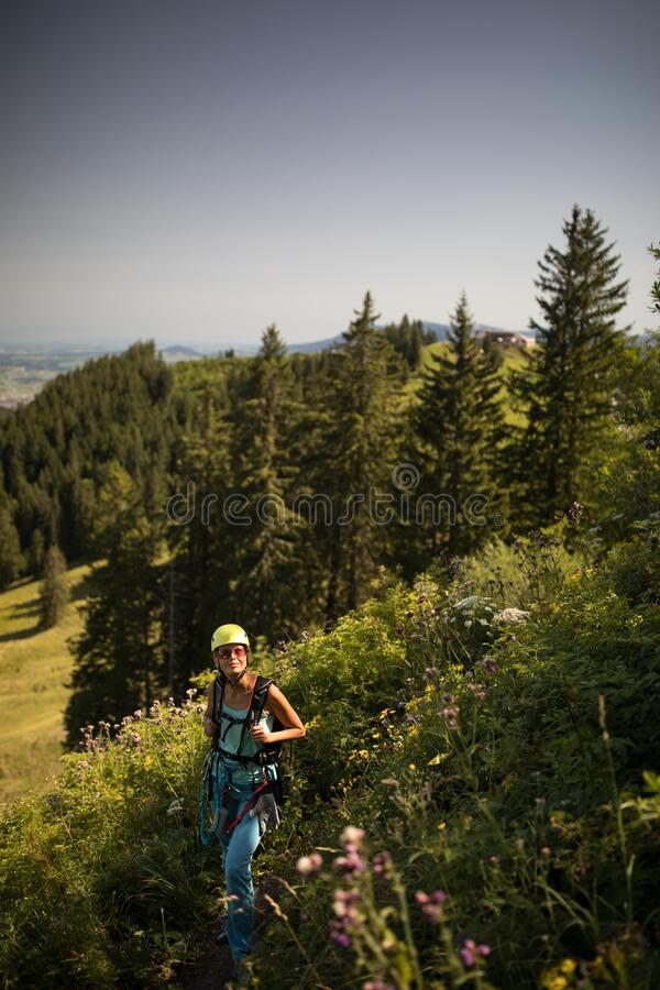 Pretty, female climber on a via ferrata stock photography