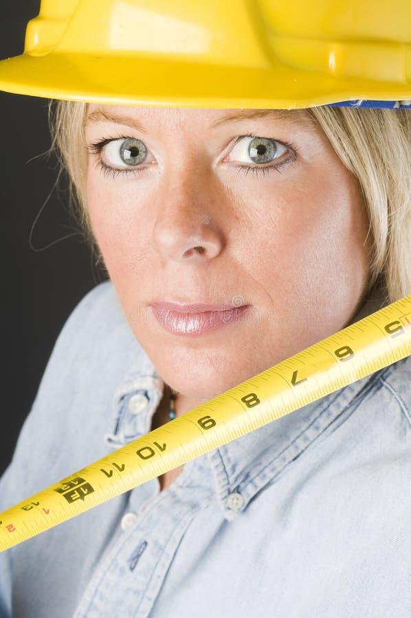 Pretty female construction worker hard hat helmet royalty free stock photo
