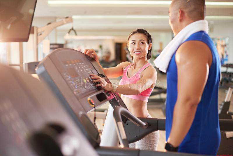 Female fitness trainer working with client royalty free stock photo