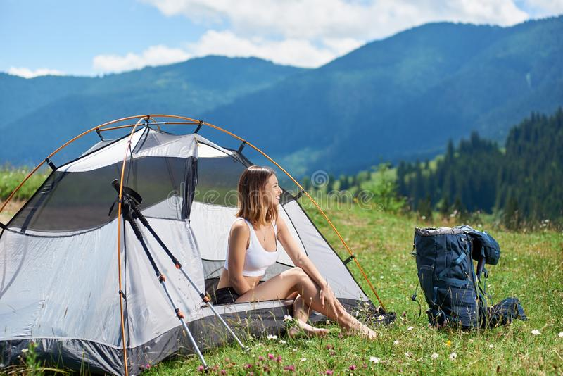 Woman hiker in the camping in the mountains with backpack in the morning royalty free stock photography