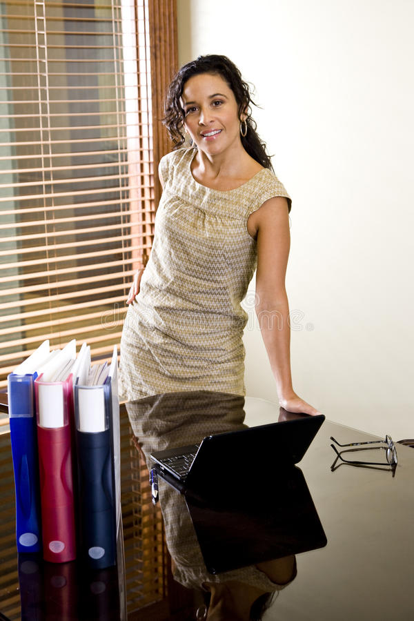 Download Pretty Female Hispanic Office Worker In Boardroom Stock Image - Image of laptop, relaxed: 11529645
