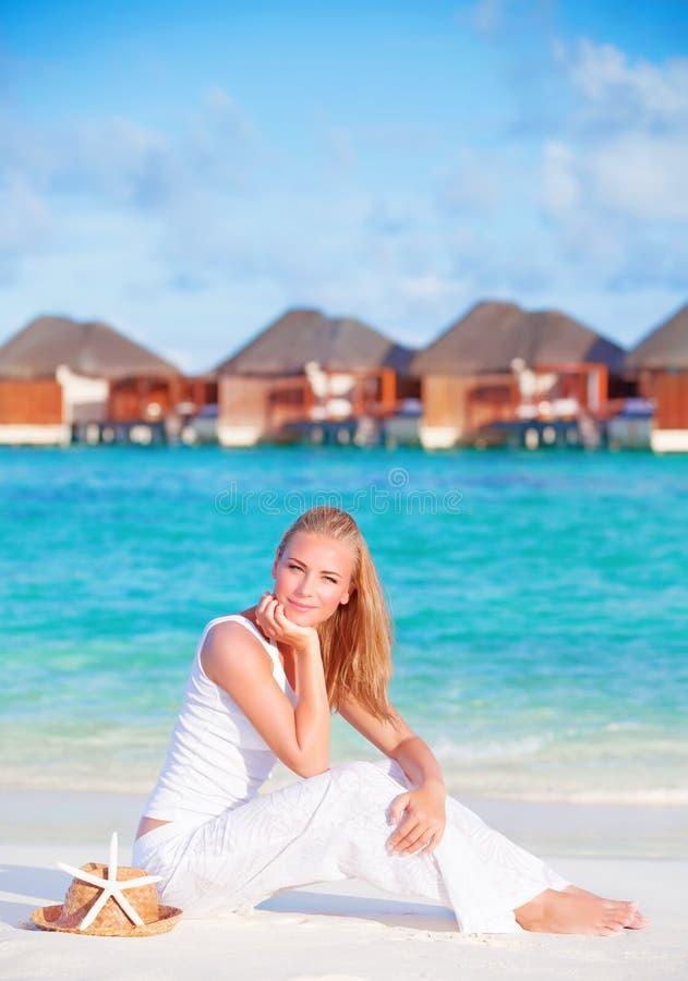 Pretty female on luxury beach resort stock photo