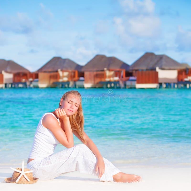 Pretty female on luxury beach resort stock images